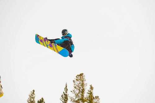 A snowboarding showing his skill