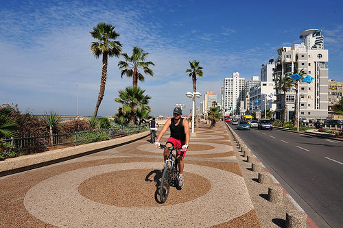 A man cycling in Tel Aviv