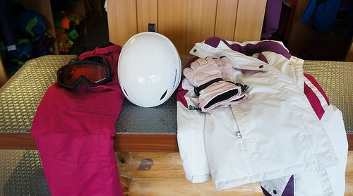 Pink, purple, and white snowboarding gear